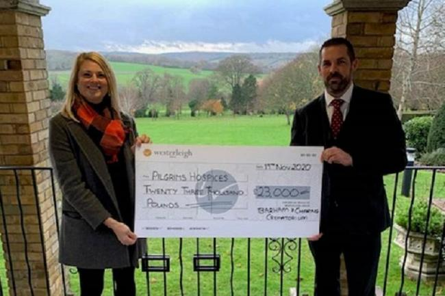 Darren Daughters giving a cheque to a representative of Pilgrims Hospices