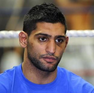 Amir Khan, pictured, has said he will not retire after losing to Danny Garcia