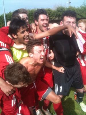 Jubilant Redhill players celebrate their win at East Preston, setting up the prospect of promotion