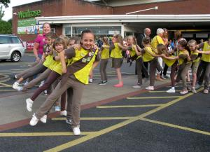 Redhill And Reigate Life: The girls of 7th Horley Brownies snaking their way around the town's Waitrose store mid-conga, with Horley mayor Richard Olliver among those joining in. Picture by Veronica Ballard.