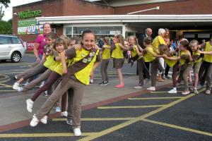 The girls of 7th Horley Brownies snaking their way around the town's Waitrose store mid-conga, with Horley mayor Richard Olliver among those joining in. Picture by Veronica Ballard.