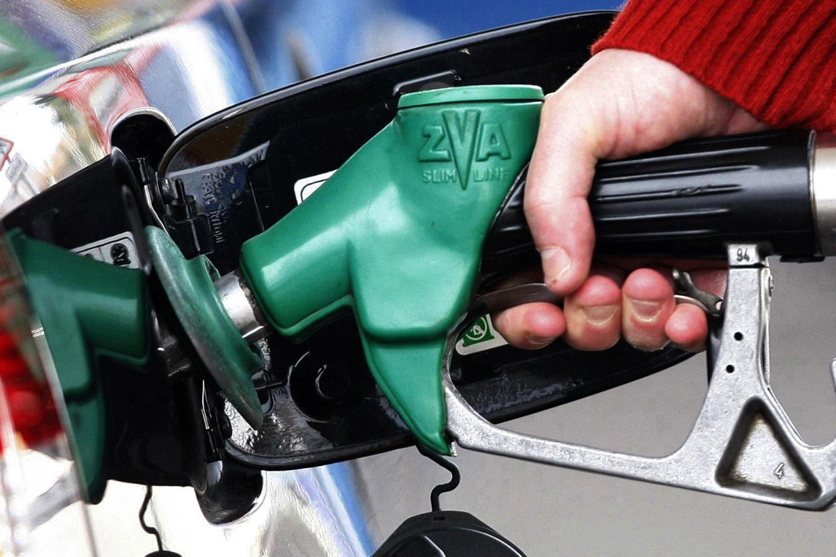 A motorist fills up their vehicle with fuel.