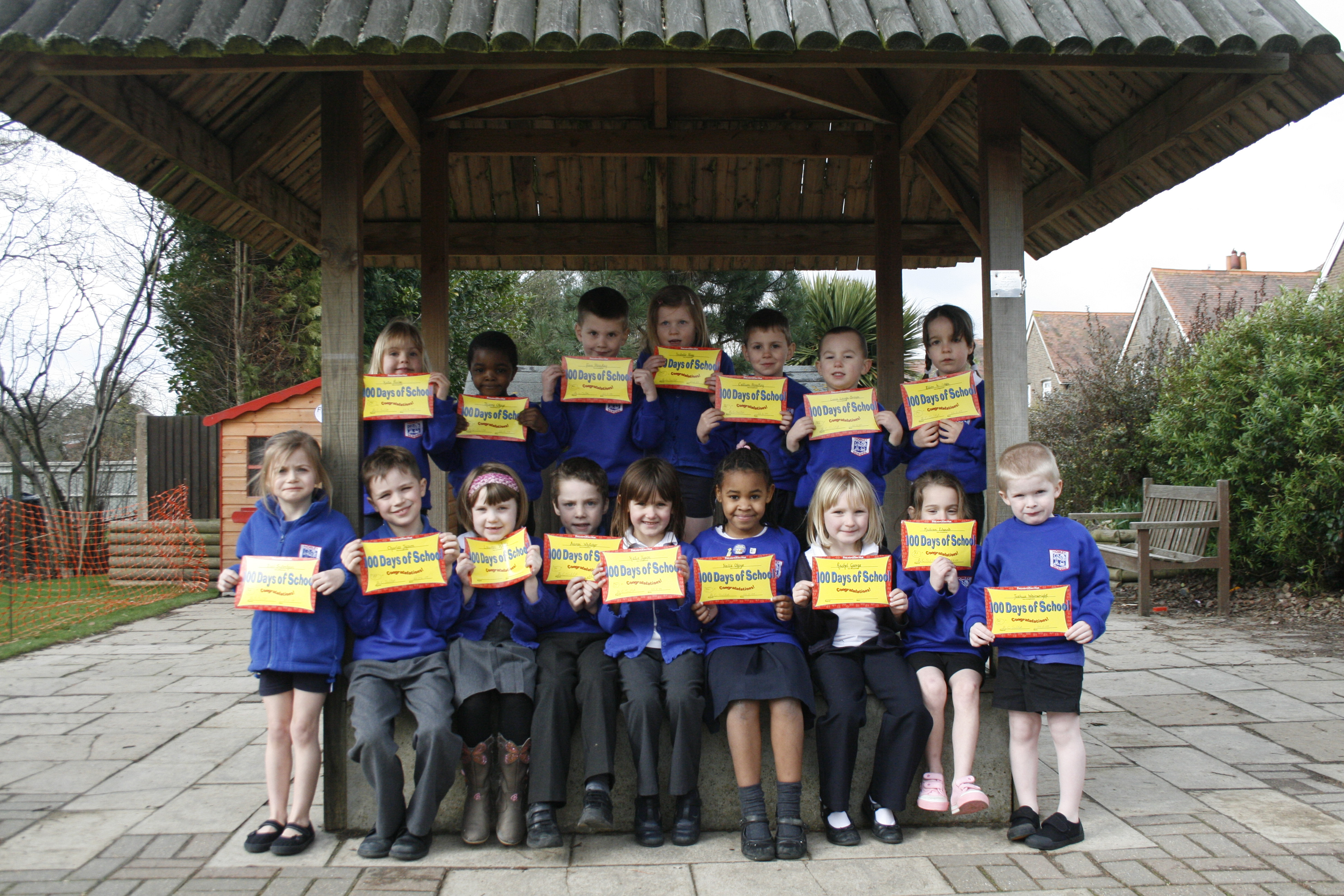 Pupils proudly show off their 100 for 100 certificates