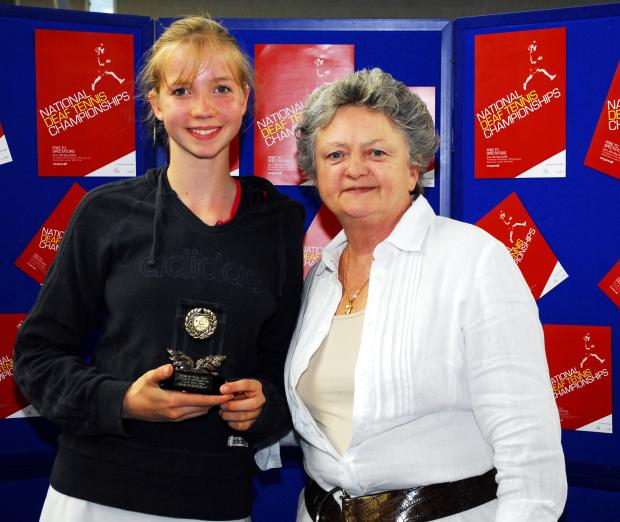 Bethany receives her women's singles trophy from Sue Mappin, executive director of The Tennis Foundation